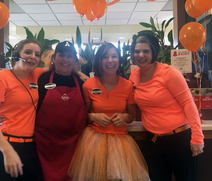 Arby's staff dressed in orange for the promotion