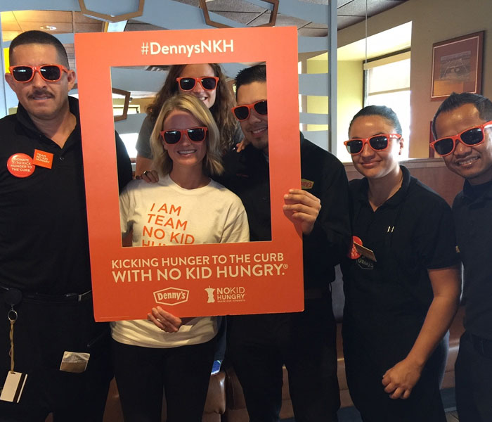 Denny's Staff with NKH branded promotional materials